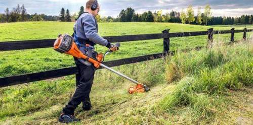 How to Insert a Fishing Line into a Husqvarna Gasoline Trimmer